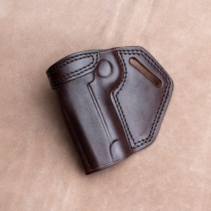Kirkpatrick crossdraw holster for the Colt commander left handed in brown