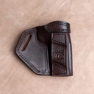 Kirkpatrick crossdraw holster for the Colt commander left handed in brown backside